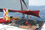Chilling on the foredeck netting on Charter catamaran Full Steam Phuket Thailand