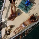 Afternoon Yacht Charters - Sunbathing on SY Yun Khan